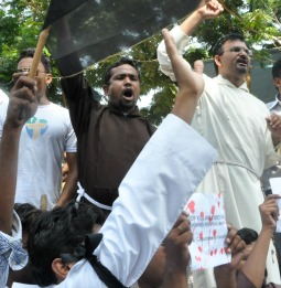 Pakistani Christians protest Sept. 23 in Karachi against the Sept. 22 terror attack that killed more than 83 people at All Saints Anglican Church in Peshawar.