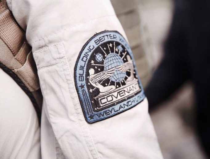 Arm-patch logos, with angel-like humanoids extending wings toward one another, as featured in Alien: Covenant.