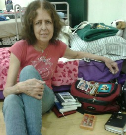 Julie Rogers, evacuated from her home, stays at a Red Cross shelter in Prescott, Ariz.