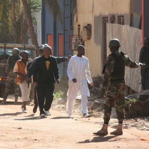 People flee from a Nov. 20 terrorist attack at the Radisson Blu Hotel in Bamako, Mali. The government of the former French colony has been fighting against  Islamic extremists with the assistance of French forces since 2013.