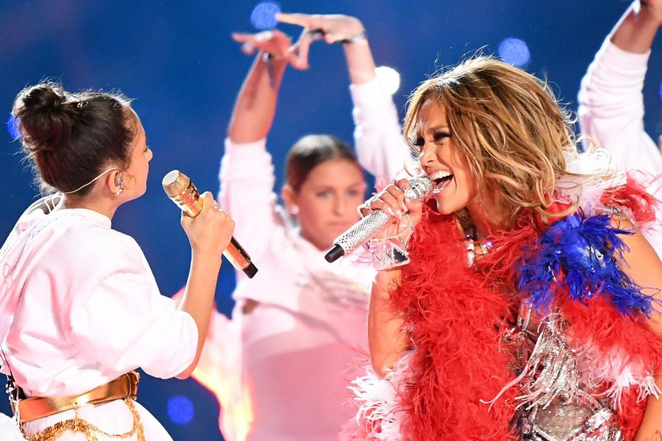 Jennifer Lopez (R) and her 11-year-old daughter Emme Maribel Muñiz perform onstage during the Pepsi Super Bowl LIV Halftime Show at Hard Rock Stadium on Feb. 2 in Miami, Florida.