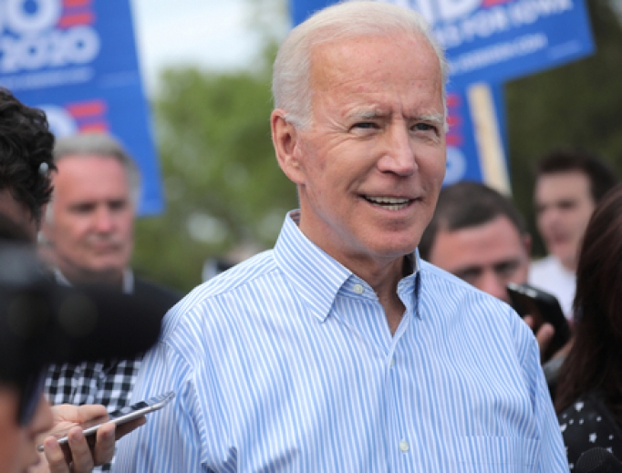 Presumptive democratic nominee Joe Biden walking with supporters at a pre-Wing Ding march from Molly McGowan Park in Clear Lake, Iowa on May 25, 2020.
