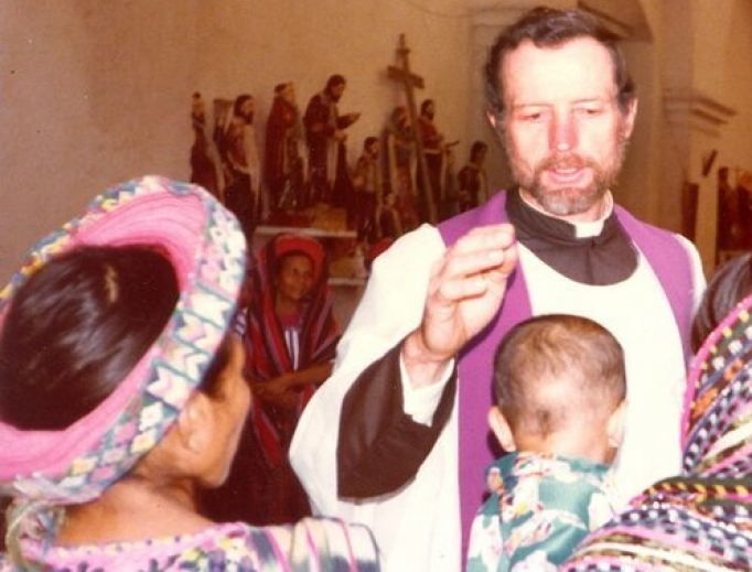 Father Stanley Rother blesses a baby and celebrates Mass in Guatemala.