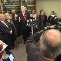 Attorney Thomas Neuberger speaks alongside victims of clergy sexual abuse during a press conference Feb. 3, the day after a $77.4 million settlement agreement was reached with the Diocese of Wilmington, Del. A priest sex-abuse case against the Oblates of St. Francis de Sales, the order that operates Salesianum School, goes to trial Feb. 27, Neuberger said.
