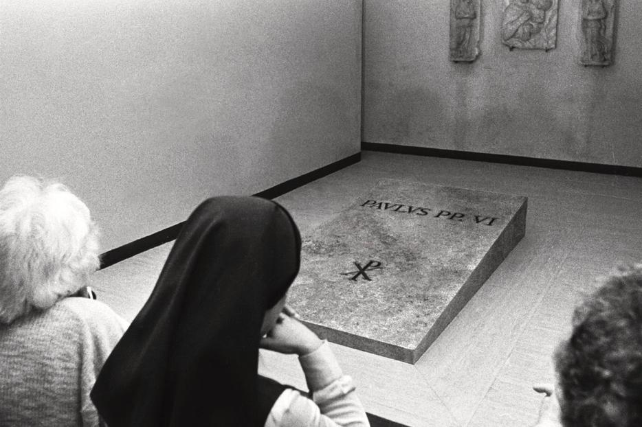 Kneeling women are seen in this Aug. 13, 1978, file photo as they pray in front of the tomb of Pope Paul VI underneath St. Peter's Basilica at the Vatican.