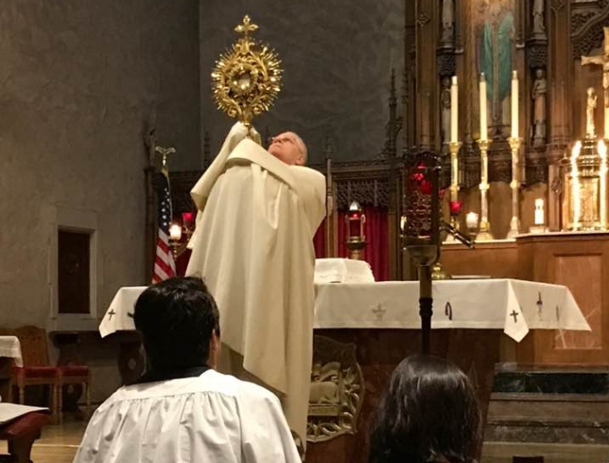 Above, Deacon Greg Kandra blesses the faithful with the Blessed Sacrament in the monstrance. In addition to priests, deacons are ministers of the exposition of the Most Blessed Sacrament and of Eucharistic benediction.