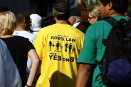 """HOPE NOT HATE. A Prop 8 supporter wears a """"Yes on 8"""" T-shirt as he arrives at a football stadium in San Diego, California November 1, 2008. Thousands of people gathered to pray for the passage of Proposition 8."""
