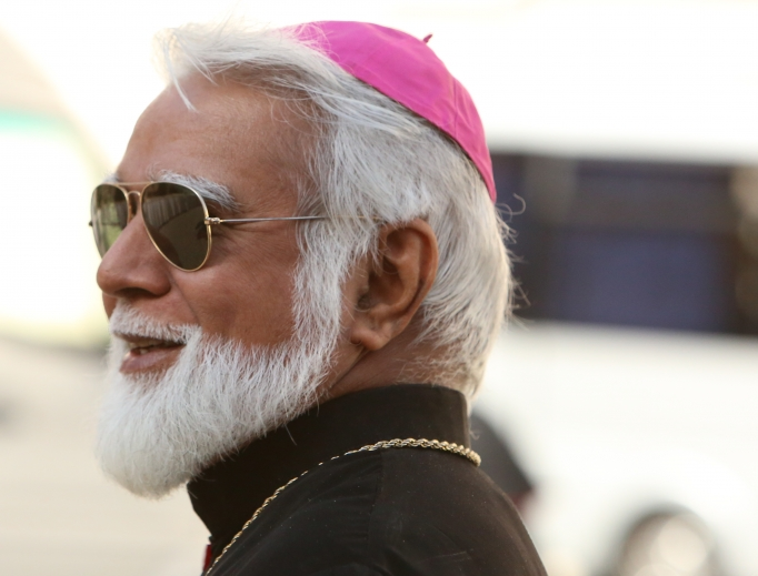 Archbishop Joseph Coutts leaves the Vatican's Synod Hall Oct. 10, 2014.