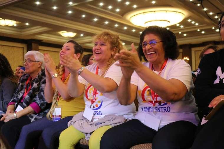 Carmen Ciriaco and Dr. Perla Indarte of Brooklyn and Mayra Reyes of Santa Fe cheer during a 'V Encuentro' session.