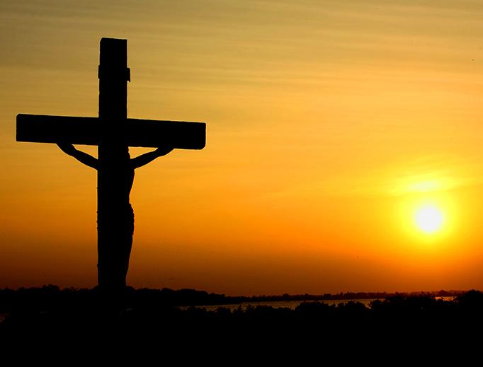 A crucifix silhouetted against the sunset in Batticaloa, Sri Lanka.
