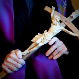 """Father Gary Thomas, pastor of Sacred Heart Church in Saratoga, Calif., holds a crucifix Oct. 31 he uses in performing an exorcism. Father Thomas' training as an exorcist is recounted in a 2009 nonfiction book titled """"The Rite: The Making of a Modern Exorcist,"""" and now the book is being made into a feature film starring Anthony Hopkins."""