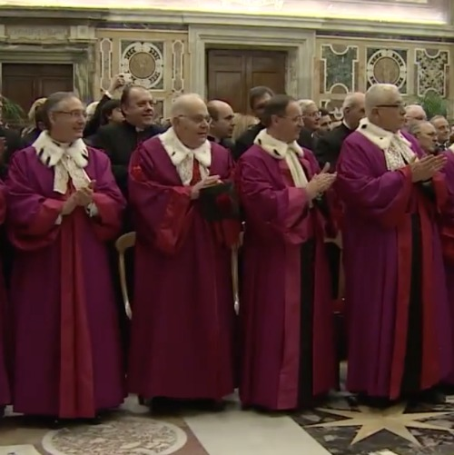 Members of the Roma Rota greet Pope Francis Jan. 23 at the Vatican.