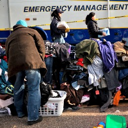 A woman searches through donated shoes at a relief center set up in a parking lot in the Midland Beach neighborhood of Staten Island.