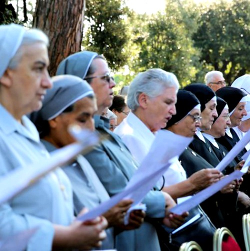 Religious sisters attend the enthronement of Our Lady of Charity in the Vatican Gardens.