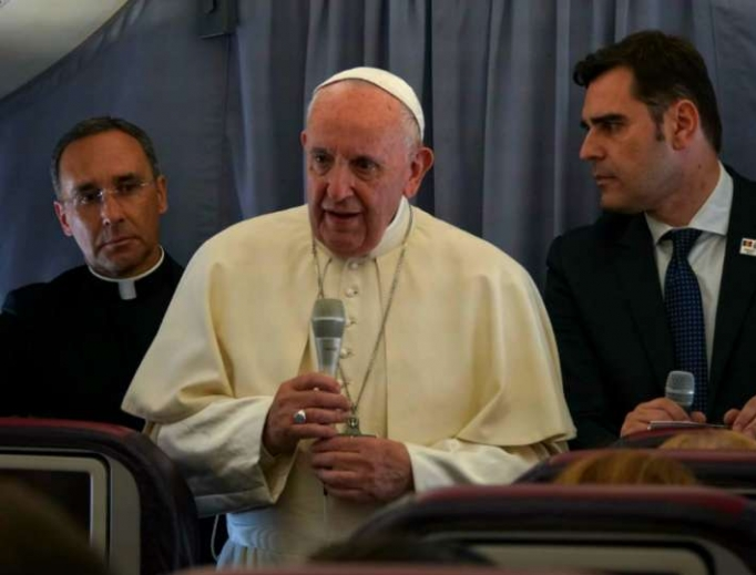 Pope Francis aboard the papal plane returning from Romania June 2, 2019.