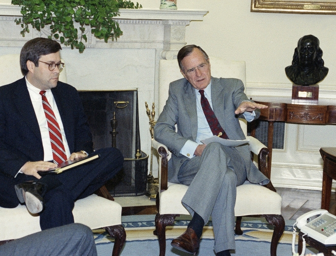 U.S. President George H. Bush gestures while talking to Attorney General William Barr in the Oval Office of the White House May 4, 1992, in Washington. The president met with top domestic cabinet officers to tackle long-range problems pushed to the forefront by the deadly riots in Los Angeles.