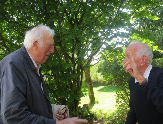 Jean Vanier (l) chats with his dear friend Paul Peeters, who is telling Vanier they will meet in heaven, Aug. 15, 2013.