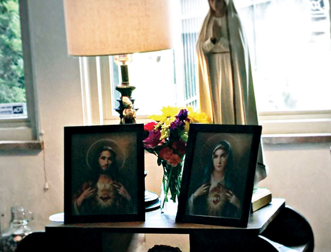 The Sacred Heart and Immaculate Heart images have pride of place in the Wilson home.