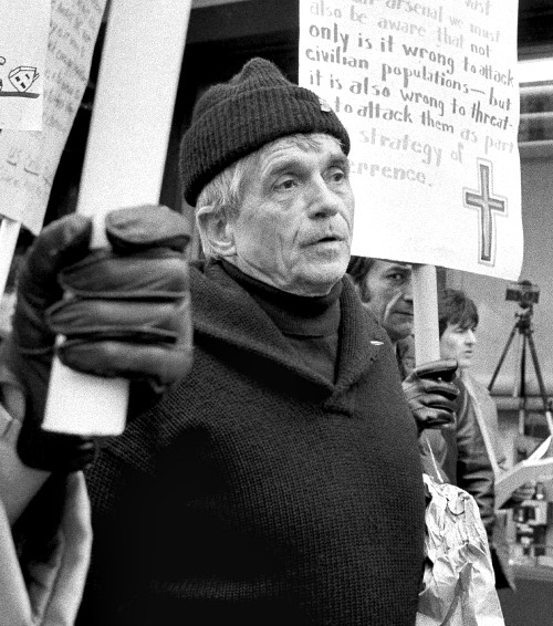 This 1982 photo shows Jesuit Father Daniel Berrigan marching with about 40 others outside of the Riverside Research Center in New York. Father Berrigan, 94, died on April 30 at a Jesuit infirmary at Fordham University.