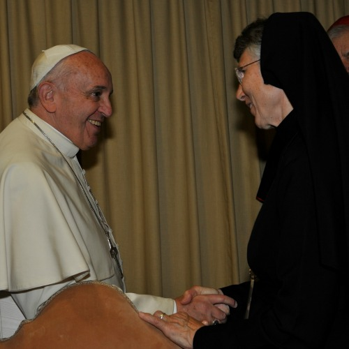 Pope Francis greets Religious Sister of Mercy Sister Mary Prudence Allen at the Humanum colloquium in the Vatican's Synod Hall on Nov. 17.