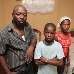 Gregoire Jean and his wife, Macula Louis, pose with their son, Makendas Jean, in their home in the Delmas 33 neighborhood of Port-au-Prince, Haiti, March 13. The family spent more than a year in a tent camp after the 2010 earthquake before feeling safe to return home.