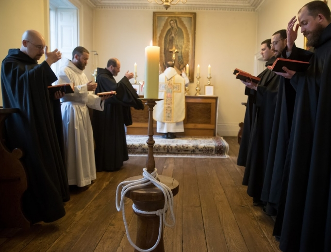 Above and below, the monks pray at Mass and have fellowship at their priory. Also below, on Feb. 25, Bishop Michael Smith of Meath presided at the canonical establishment of their new monastery at Silverstream.