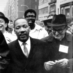 Rev. Martin Luther King Jr. and Msgr. Charles Owen Rice march to the United Nations in New York.