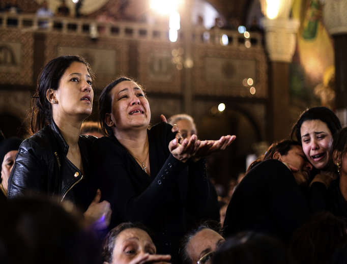 Women cry during the April 10 funeral for those killed in a Palm Sunday church attack in Alexandria, Egypt, at the Mar Amina Church. Egyptian Christians were burying their dead on Monday, a day after Islamic State suicide bombers killed at least 45 people in coordinated attacks targeting Palm Sunday services in two cities. Women wailed as caskets marked with the word 'martyr' were brought into the church in the coastal city of Alexandria, the footage broadcast on several Egyptian channels.