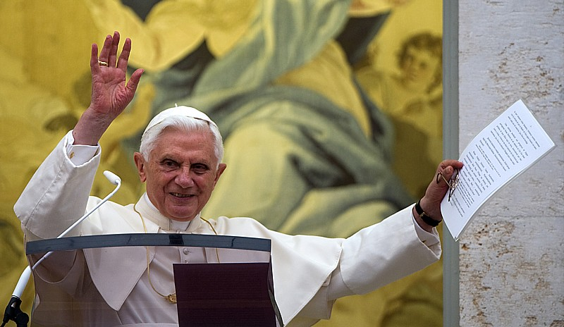 Pope Benedict XVI waves from the balcony during his Angelus prayer Aug. 15, the feast of the Assumption of Mary, at his summer residence in Castel Gandolfo, Italy.