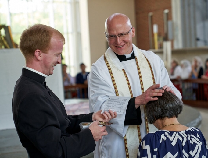 Father Michael Cunningham gives a priestly blessing.