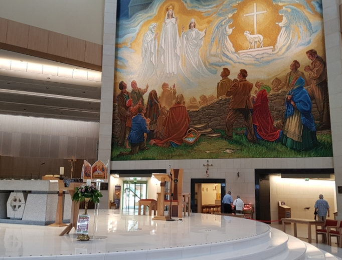 The 1879 apparition of the Virgin Mary, St. Joseph, St. John the Evangelist, angels and the Lamb of God is commemorated inside the Knock Shrine.