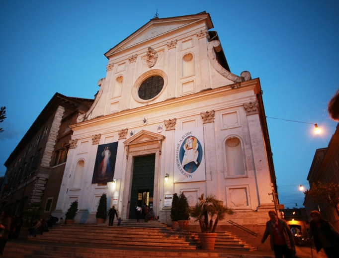The Shrine of Mercy in the Santo Spirito in Sassia Church in Rome, Italy, including images of Pope St. John Paul II and St. Faustina.