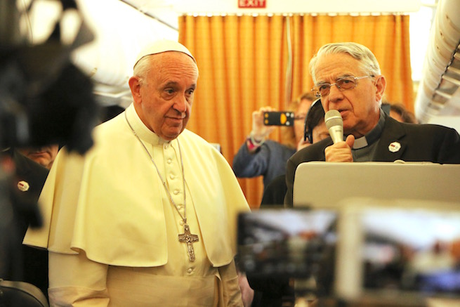 Pope Francis and Father Federico Lombardi speaking to reporters on the papal plane to Armenia, June 24, 2016