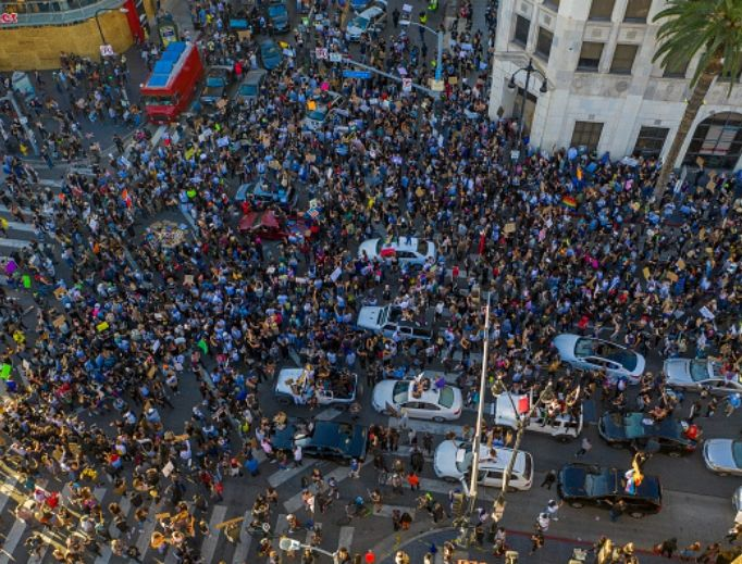 Protesters congregate June 7 at the Hollywood and Highland intersection as demonstrations continue over the killing of George Floyd in Los Angeles. An estimated 20,000 to 30,000 people marched to protest racism and police violence peacefully, in keeping with the recent trend, through Hollywood.