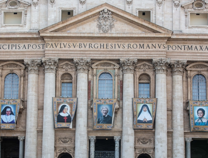 The official canonization banners of the five new saints hang in St. Peter's Square.