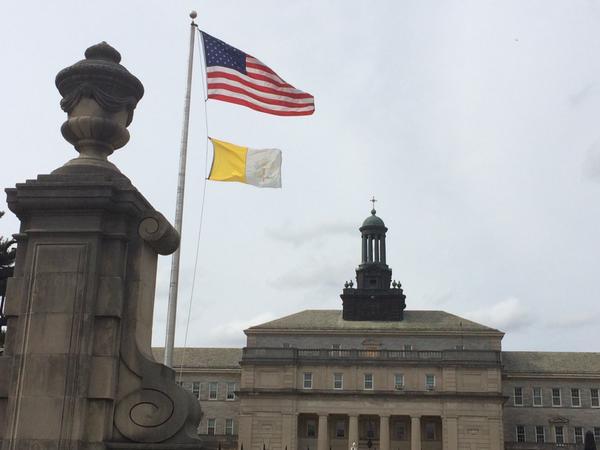 U.S. and Vatican flags fly at St. Charles Borromeo Seminary outside of Philadelphia.