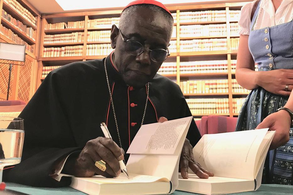 Cardinal Robert Sarah signing his book 'The Power of Silence' in Rome, May 24, 2017.