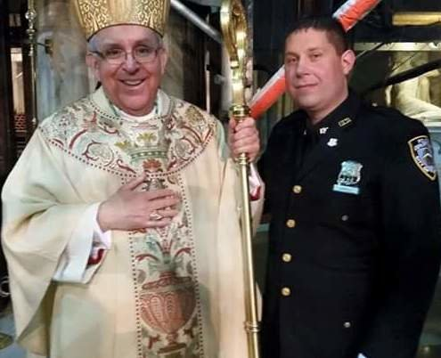 Officer Charlie Carroll with Bishop John O'Hara, auxiliary bishop of the Archdiocese of New York.