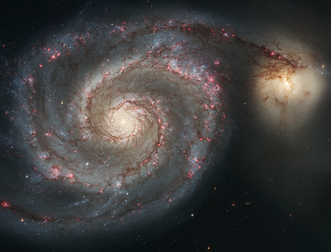 The Whirlpool Galaxy (M51, NGC 5194) and its companion NGC 5195. Photo courtesy of NASA and the European Space Agency.