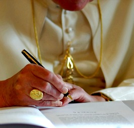 Pope Benedict XVI signs his second encyclical, Spe Salvi, in November 2007.