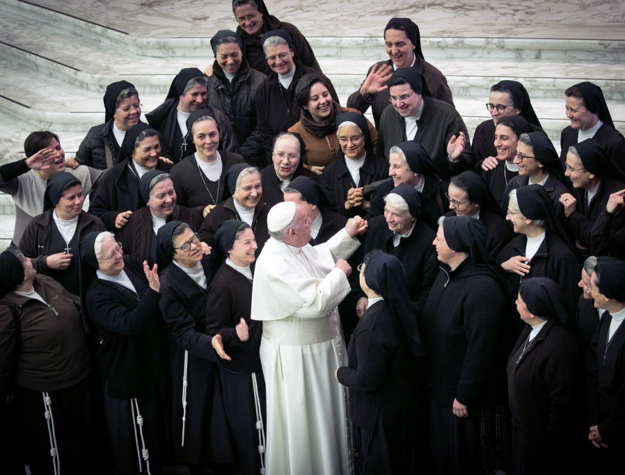 Pope Francis greets a group of sisters during his weekly audience at the Paul VI Hall Jan. 15.