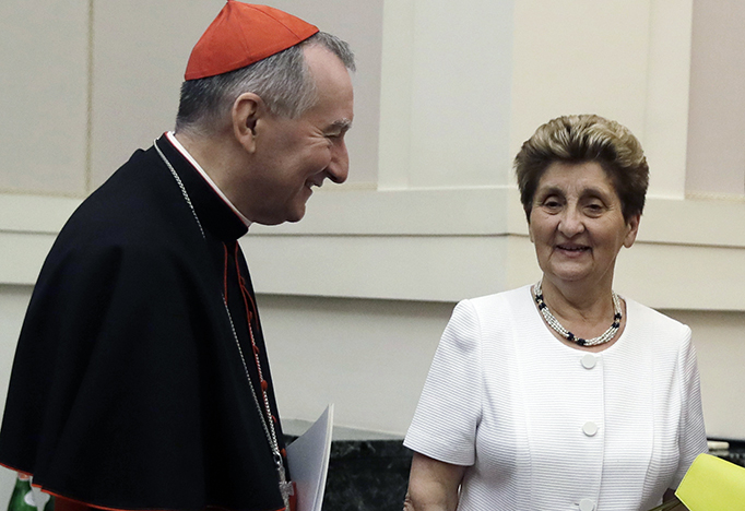 Cardinal Pietro Parolin, the Vatican's secretary of state, meets with Mariella Enoc, the president of Bambino Gesu Pediatric Hospital at an event to release the hospital's annual report at the Vatican.