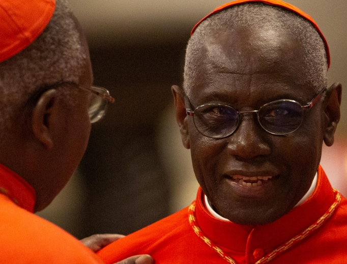 Cardinal Robert Sarah (R) attending the Oct. 5, 2019, consistory for cardinals in St. Peter's Basilica, stresses, 'One is called by God, and the Church confirms this call. Celibacy guarantees this call.'