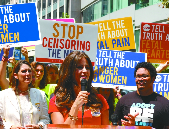 Lila Rose of Live Action, shown speaking during the 'March on the Media' in Washington on Aug. 9, 2013, says that as a new mother herself she is 'more committed than ever' to fighting for all of the tiny lives in the womb.