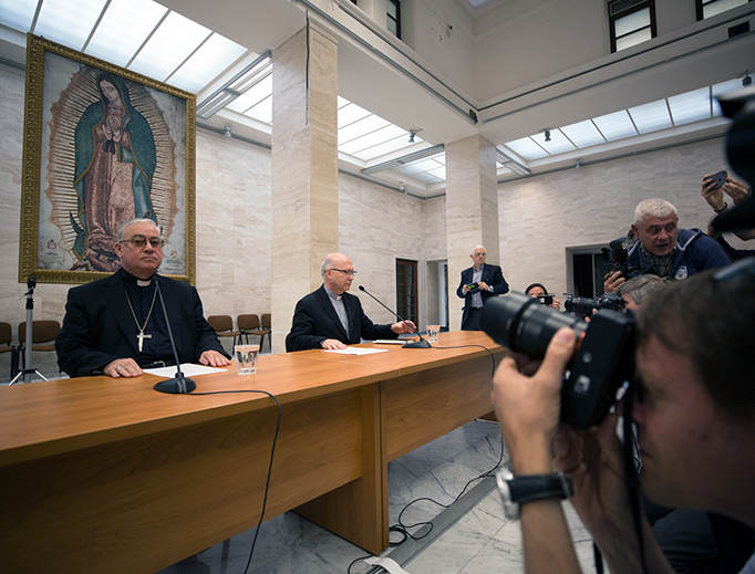Bishop Fernando Ramos, auxiliary bishop of Santiago, and Bishop Juan Ignacio González of San Bernardo, a member of Chile's national commission for the protection of minors, at a press conference on May 18, 2018 announcing the resignation of all 34 Chilean bishops at the close of their 3-day meeting with Pope Francis in Vatican City.