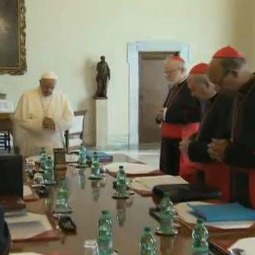 Pope Francis prays with the members of the council of cardinals during their initial meeting Oct. 1, 2013.