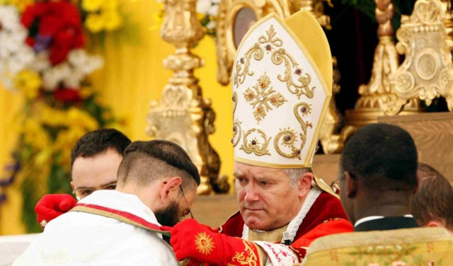 Bishop Bernard Fellay, superior general of the Society of St. Pius X, ordains a priest during a ceremony in Econe, Switzerland, June 29.