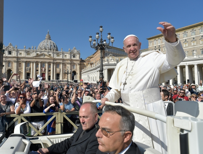 Pope Francis waves to the faithful after celebrating a Mass for the opening of the youth-focused Synod of Bishops Oct. 3 in St. Peter's Square. The synod, which runs through Oct. 28, brings together 266 bishops from five continents.