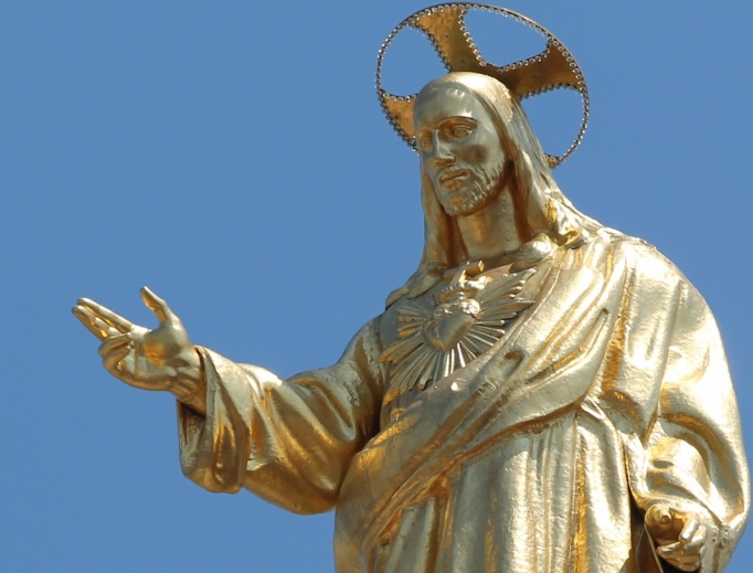 A golden statue of the Sacred Heart of Jesus at the Basilica of the Sacred Heart of Jesus in Rome.