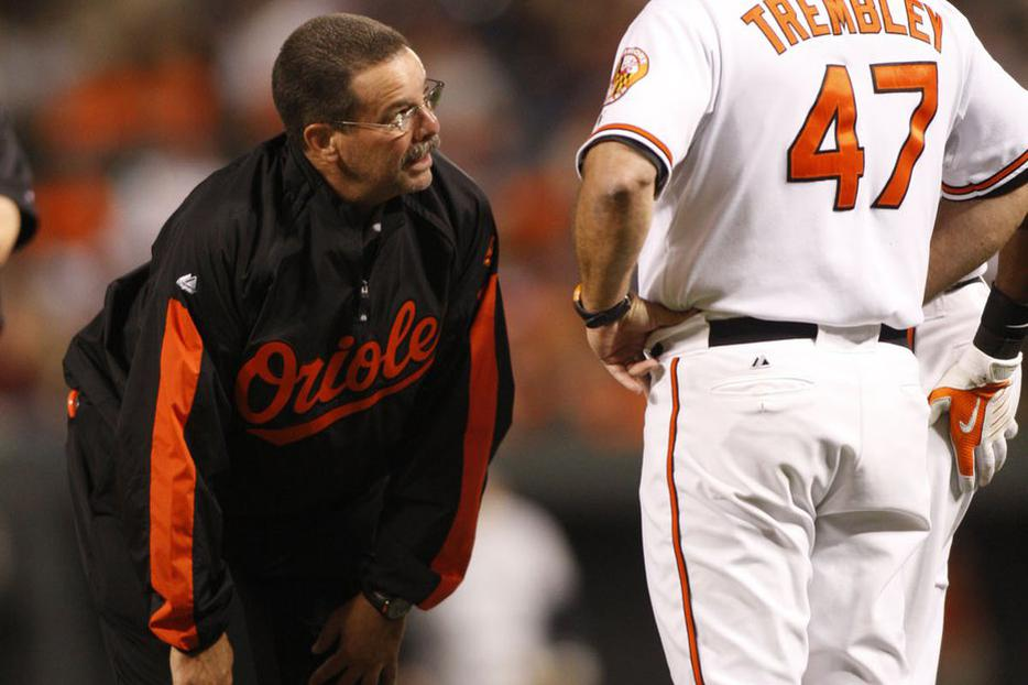 Baltimore Orioles athletic trainer Richie Bancells talks with an Orioles player.